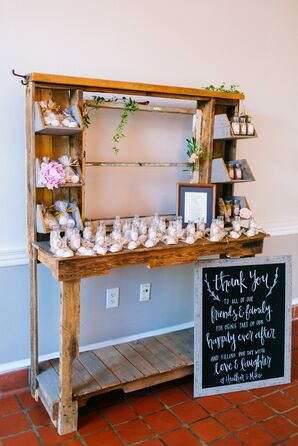 Wood Desk with Favors and Chalkboard Sign