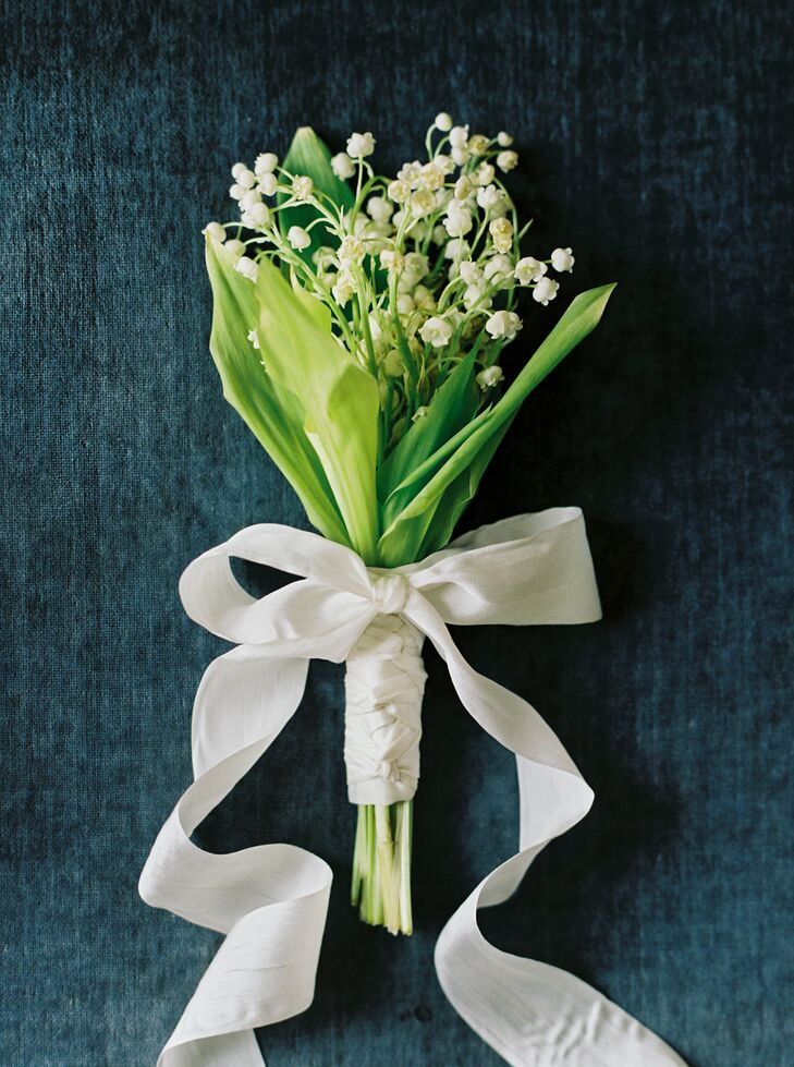 """""""I have always loved lilies of the valley and wanted to have a delicate bunch of flowers to carry,"""" Liv says. Liv's mother, June, who is a floral designer, created a dainty bouquet of lilies of the valley for Liv's walk down the aisle. For a bit of extra oomph, she tied the bouquet with a length of silky ivory ribbon."""
