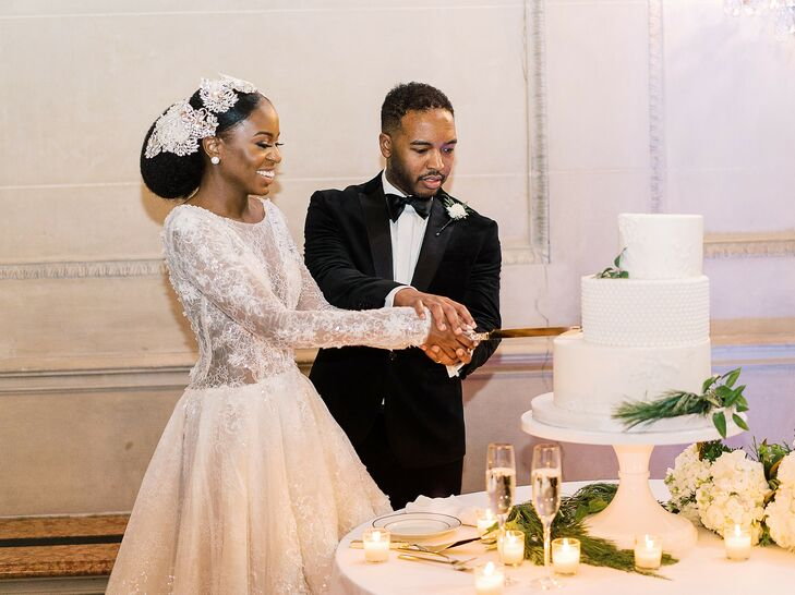 Bride and Groom Cutting White Staircase Wedding Cake