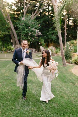 Groom Holding Bride's Veil While Walking in Granite Bay, California