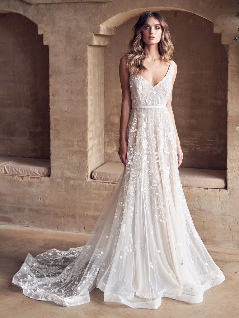 anna campbell white a line wedding dress with thick straps v-neckline flowy skirt and lace