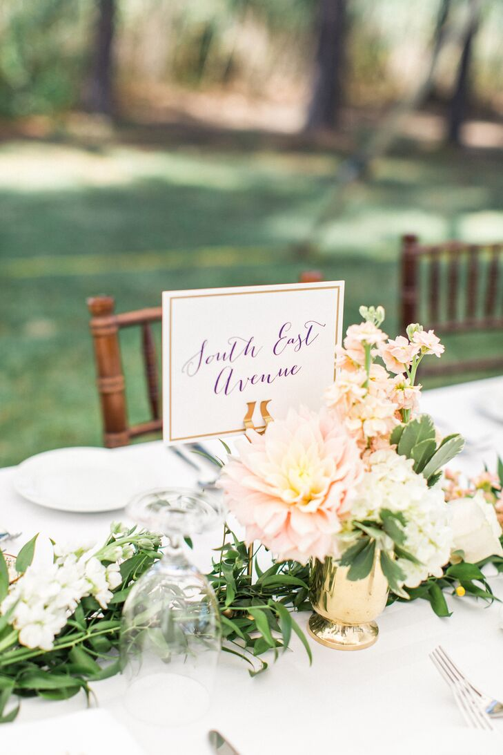 In lieu of table numbers, the couple labeled tables as street names, and listed navigational coordinates.