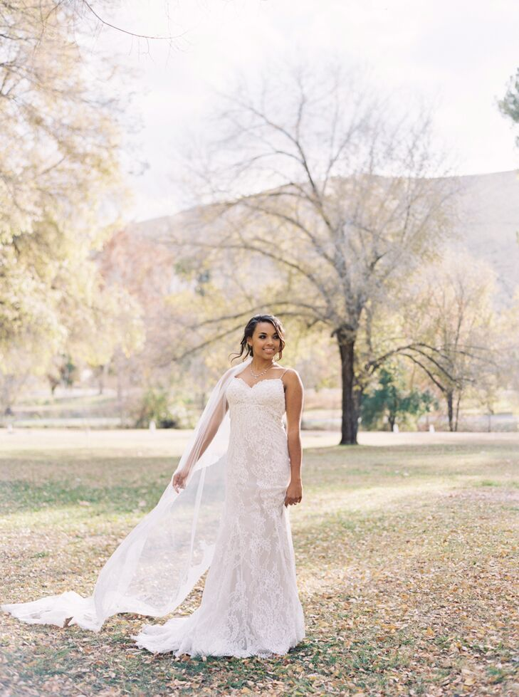 """""""My dress was designed by Justin Alexander,"""" Danika says. """"The fabric was lace on the outside with an inner slip that was a nude color that paired really well with my skin complexion. It was pretty slimming throughout with a beautiful lace tail that continued without the slip underneath."""""""