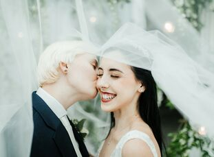 """Jordyn and Kimilee """"knew from the start that we wanted a floral-focused wedding,"""" says Kimilee of the couple's garden-inspired wedding in Orlando, Flo"""