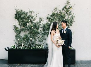 For their romantic rooftop wedding, OliviaTran and Phu Le drew inspiration from Japanese cherry blossoms. The delicate pink flower showed up everywhe