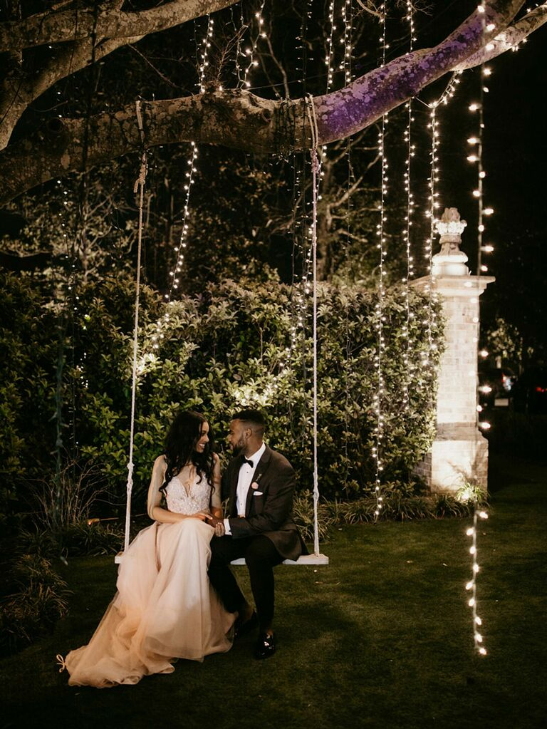 Cottagecore inspired wedding string lights and outdoor swing