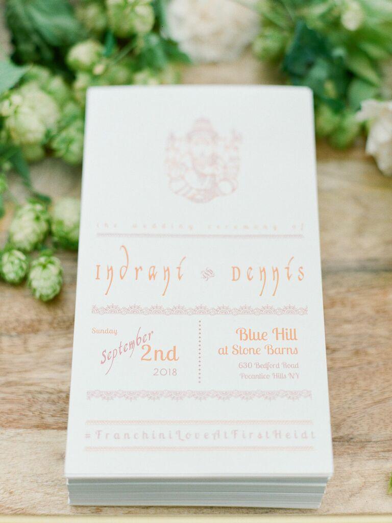 Wedding ceremony program with custom hashtag printed on bottom