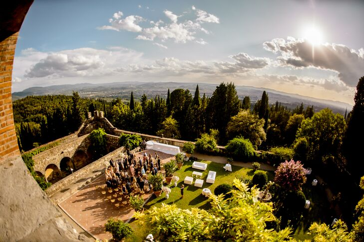"""Though Lindsay and Robert knew they wanted a destination affair to ensure an element of intimacy for their early-fall wedding, a Tuscan backdrop came as a surprise. """"When looking for a venue, I searched 'European wedding venues' on Pinterest and a beautiful 13th-century castle was one of the first pictures to appear,"""" Lindsay says. """"I was instantly in love."""" When the couple saw the romantic medieval architecture and expansive views of the Italian countryside, they knew they had found their venue."""