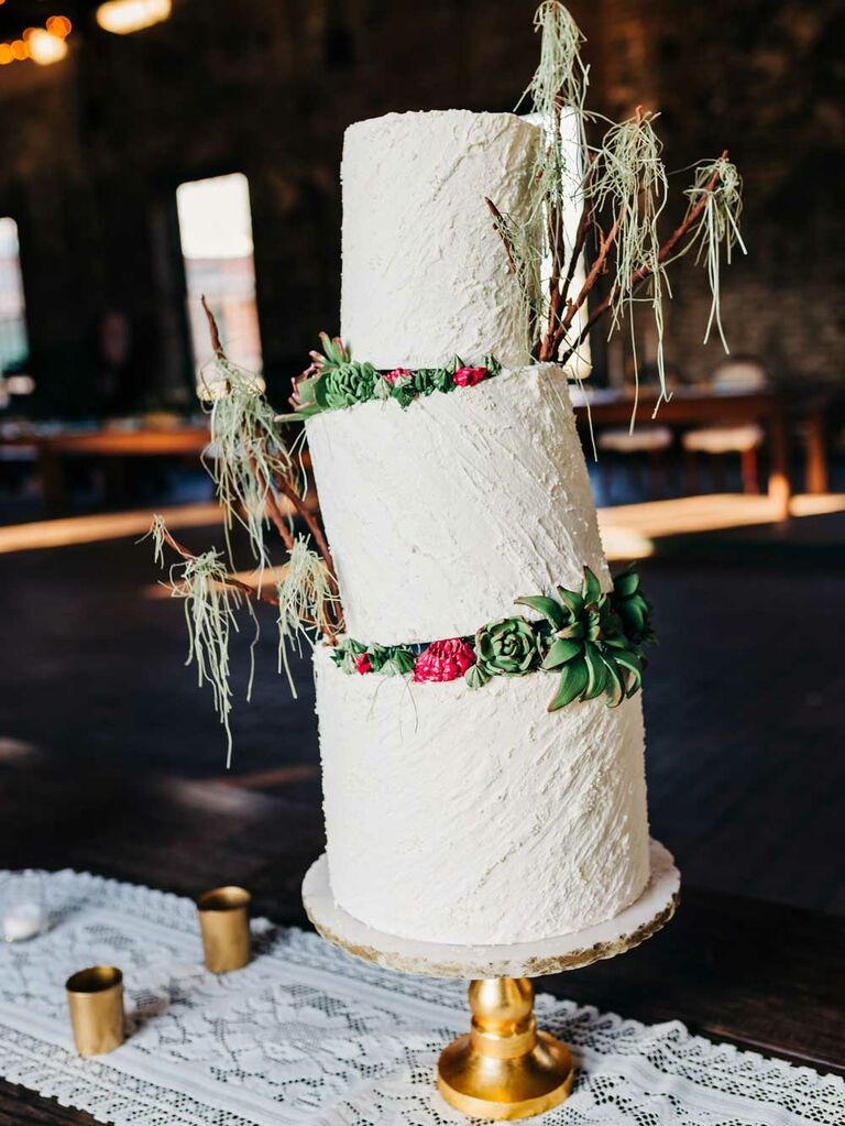 Wedding cake with tilted tiers and Spanish moss