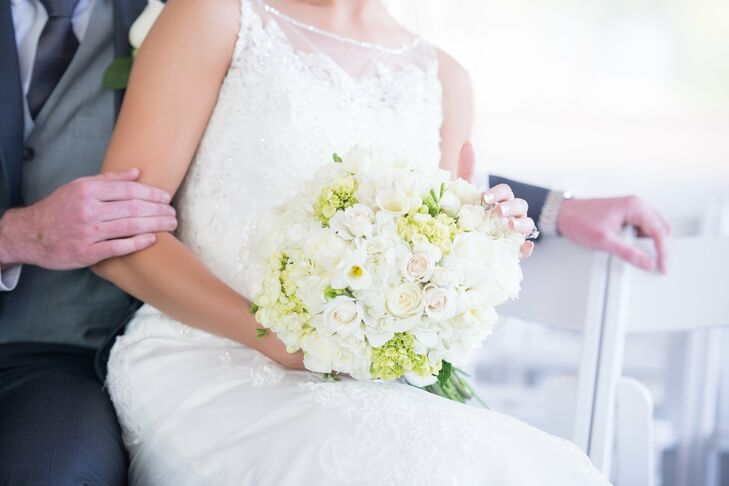 Brianna carried a white, textured bouquet of hydrangeas, roses and freesia with pops of greens.