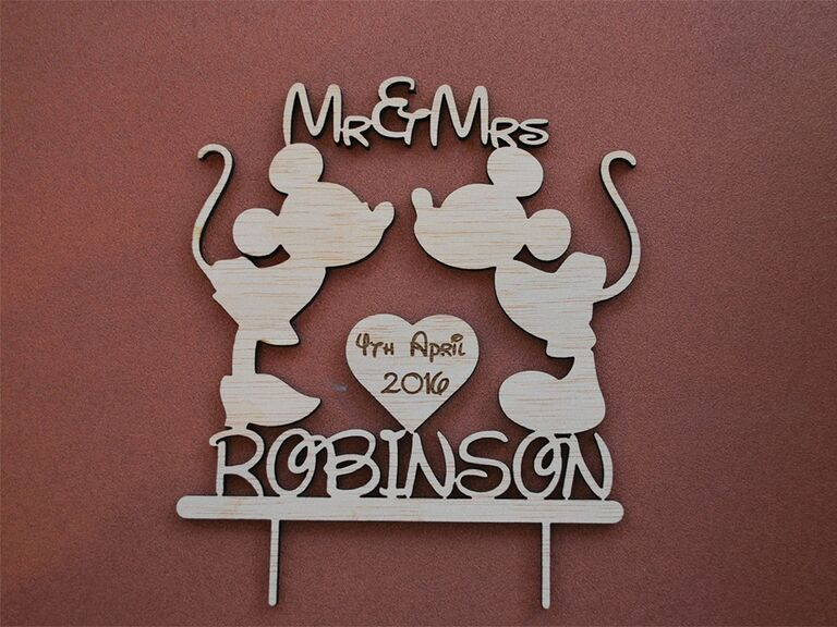 Wooden kissing Mickey and Minnie with couple's names in Disney font and wedding date in heart