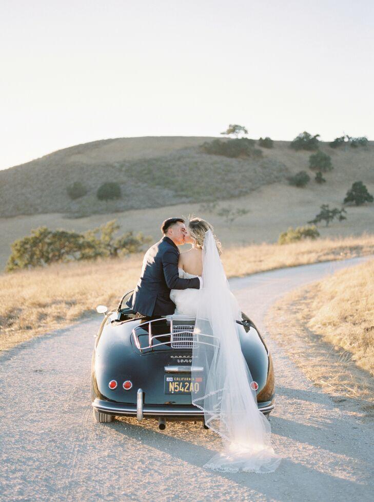 Bride and Groom Share a Kiss on a Vintage Car
