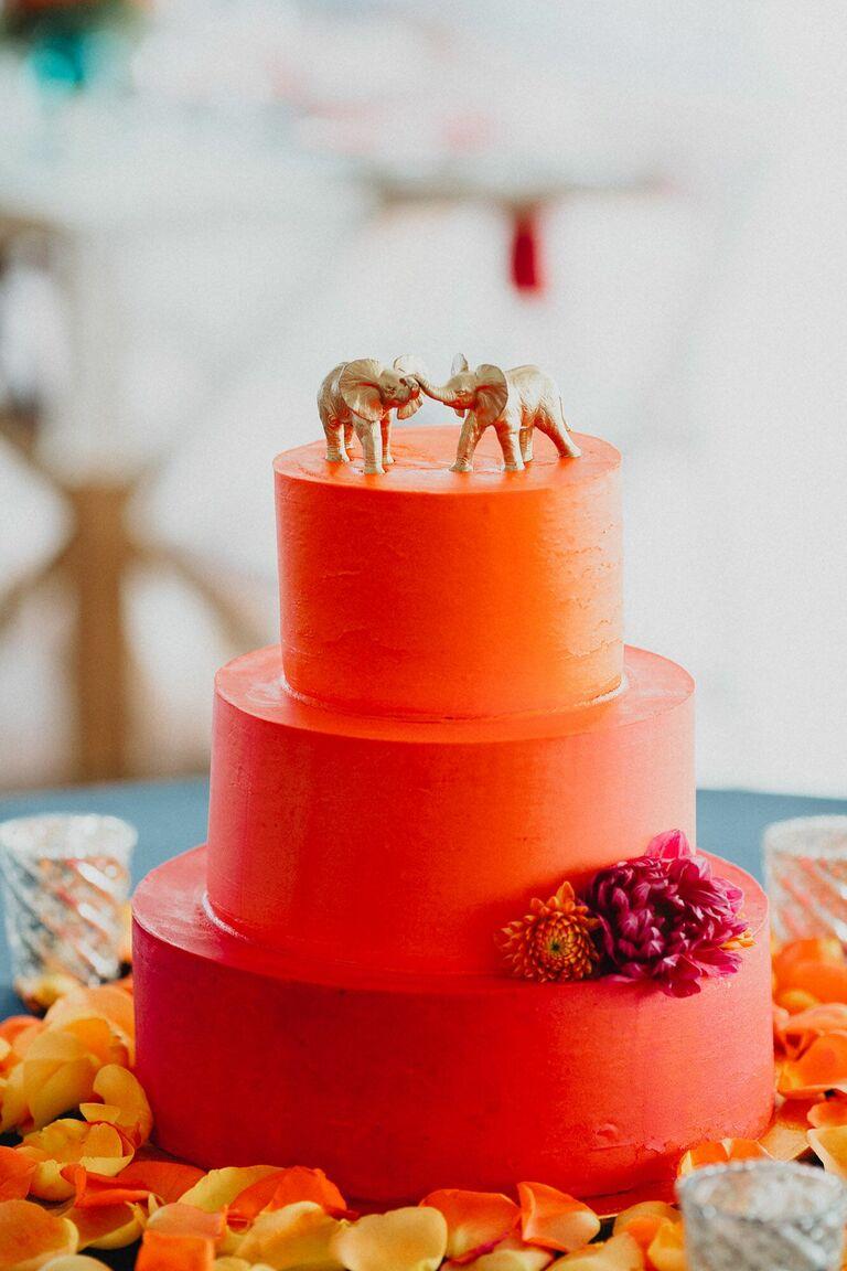Three-tier bright orange wedding cake