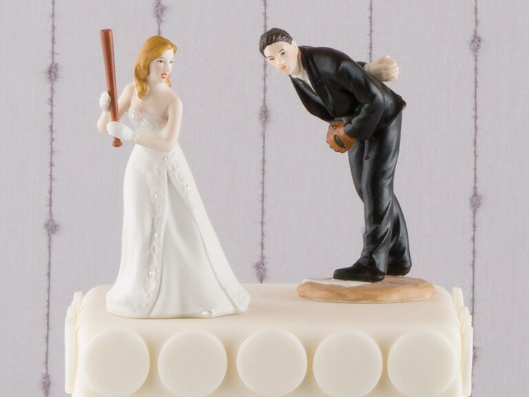 Bride holding baseball bat, groom about to pitch