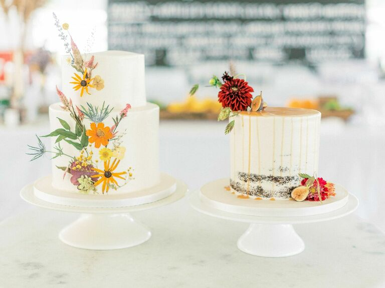 Two rustic wedding cakes with pressed flowers
