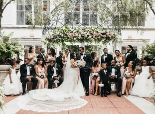 Kelly and Michael tied the knot in a romantic courtyard wedding ceremony at the Ritz-Carlton packed with pink-and-mauve flowers before celebrating wit