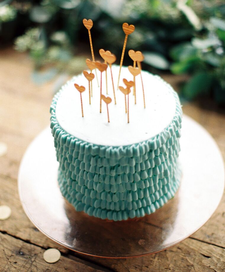 Ruffle frosted bridal shower cake with wooden heart toppers