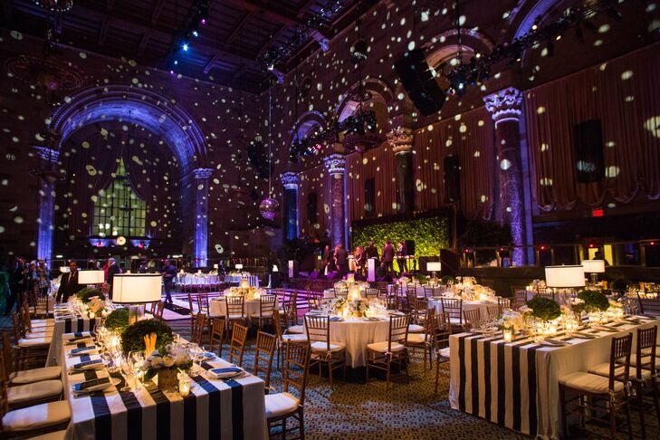 """New York City natives Leigh and Micah, who dated for more than 13 years before getting engaged, wanted a wedding space that had a sense of local history. """"Cipriani 42nd Street was a great, iconic New York venue,"""" Leigh says. She and Micah used décor and lighting to create a """"cozy, romantic and chic vibe"""" for the reception."""