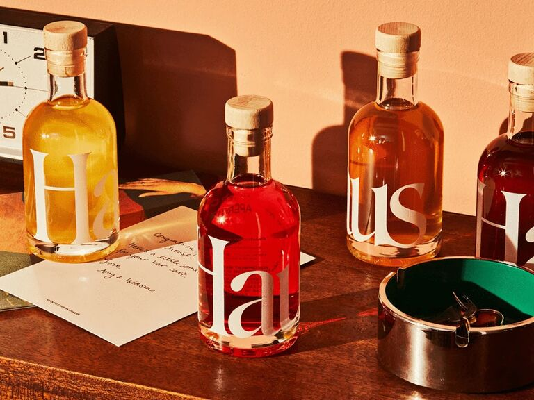 Four bottles of Haus aperitifs in different colors