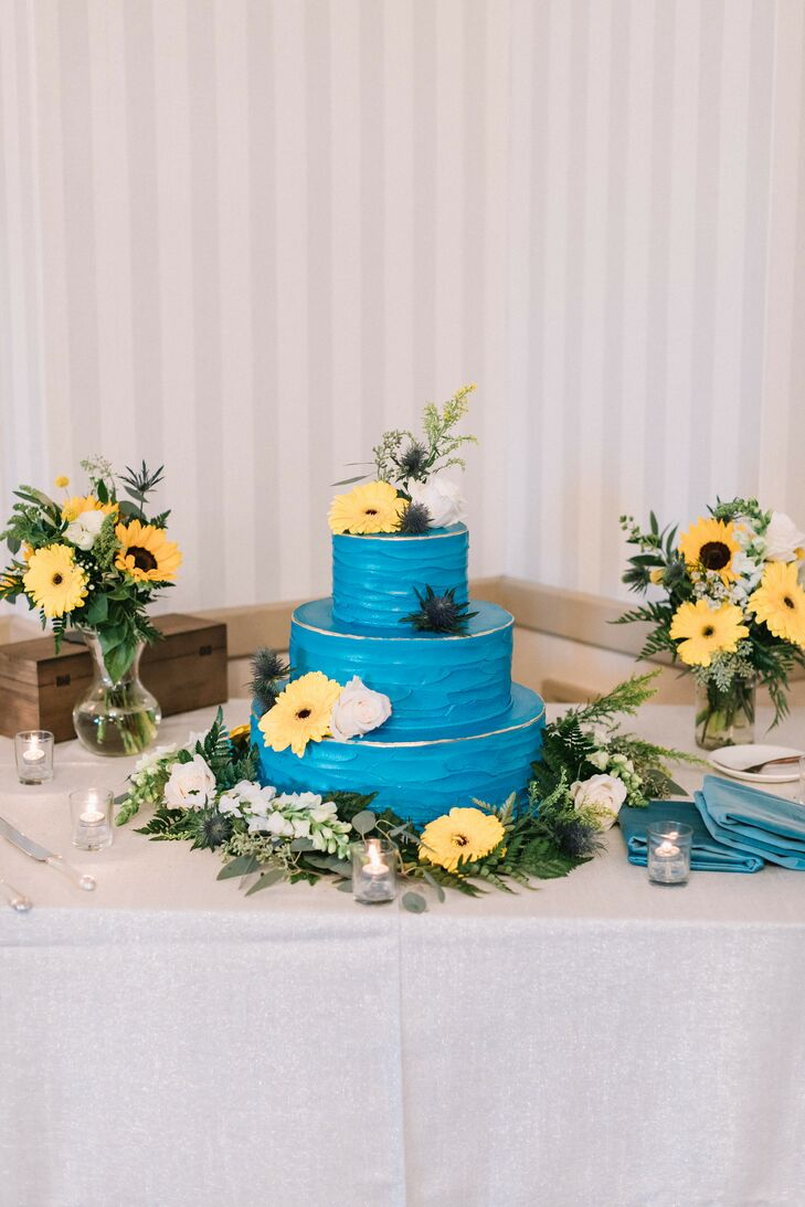 Blue Tiered Wedding Cake with Sunflowers