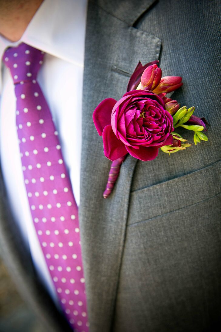A fuchsia ranunculus flower was wrapped up in a special ribbon that matched the bride's bouquet wrap.
