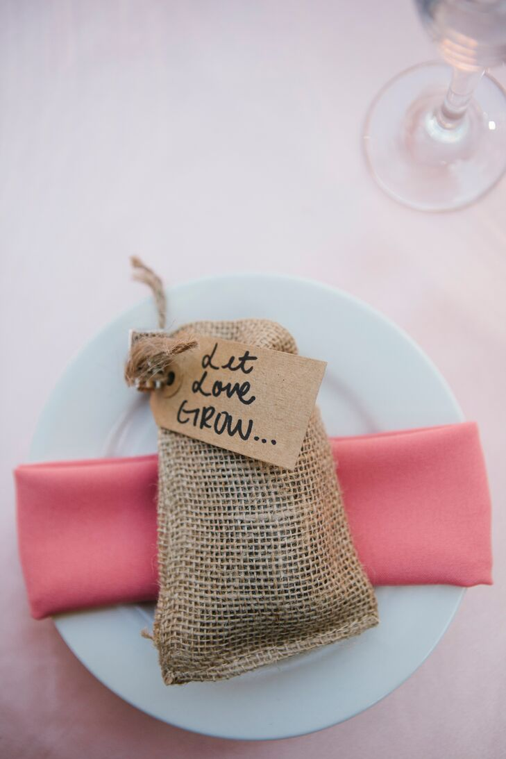 """Guests took home burlap bags filled with wildflower seeds and fertilizer, with a tag attached by twine that read """"Let Love Grow."""""""