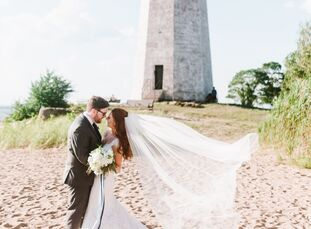 Watercolor stationery, striped flower girl dresses and blue flower arrangements lent a decidedly nautical feel to Mary Boynton (25 and a teacher) and