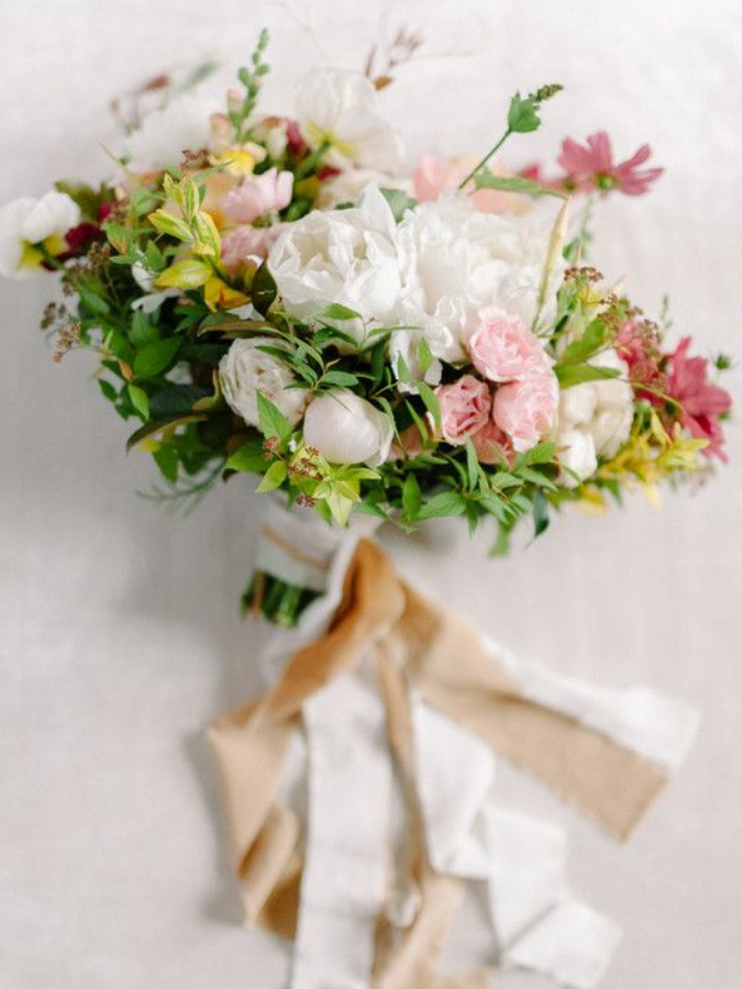 colorful garden-inspired bouquet with ribbon