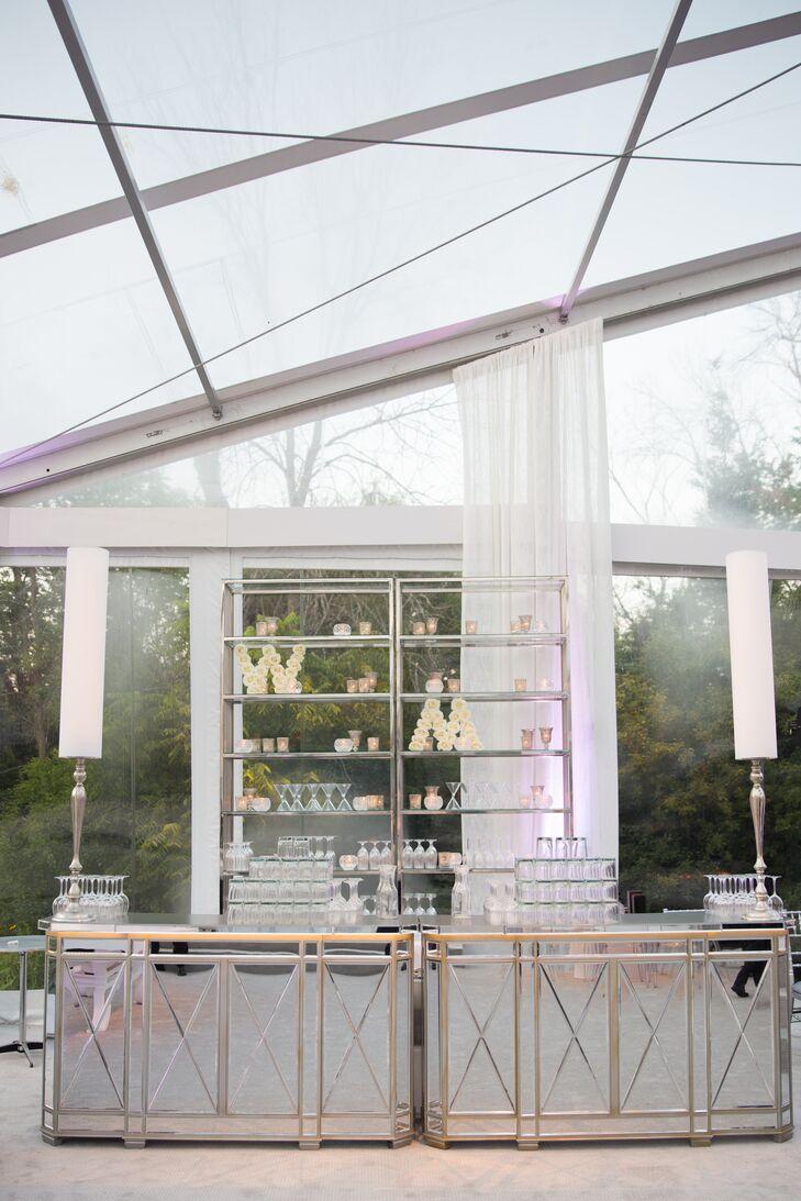 Mirrored bars gave Whitney and Matt's sophisticated tented reception in Bannockburn, Illinois, a glam yet elegant feel.