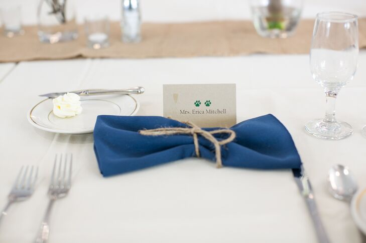 """""""The mascot is a bobcat and often the paw print is used in Ohio University apparel and gear. We had this paw-print symbol appear throughout the wedding,"""" says the couple. """"It was a tag that tied the initiations together, it was present on the programs and on the place cards as markers for what entree the guests were having."""""""