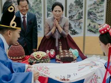 Couple participating in pye-baek ceremony at Korean wedding