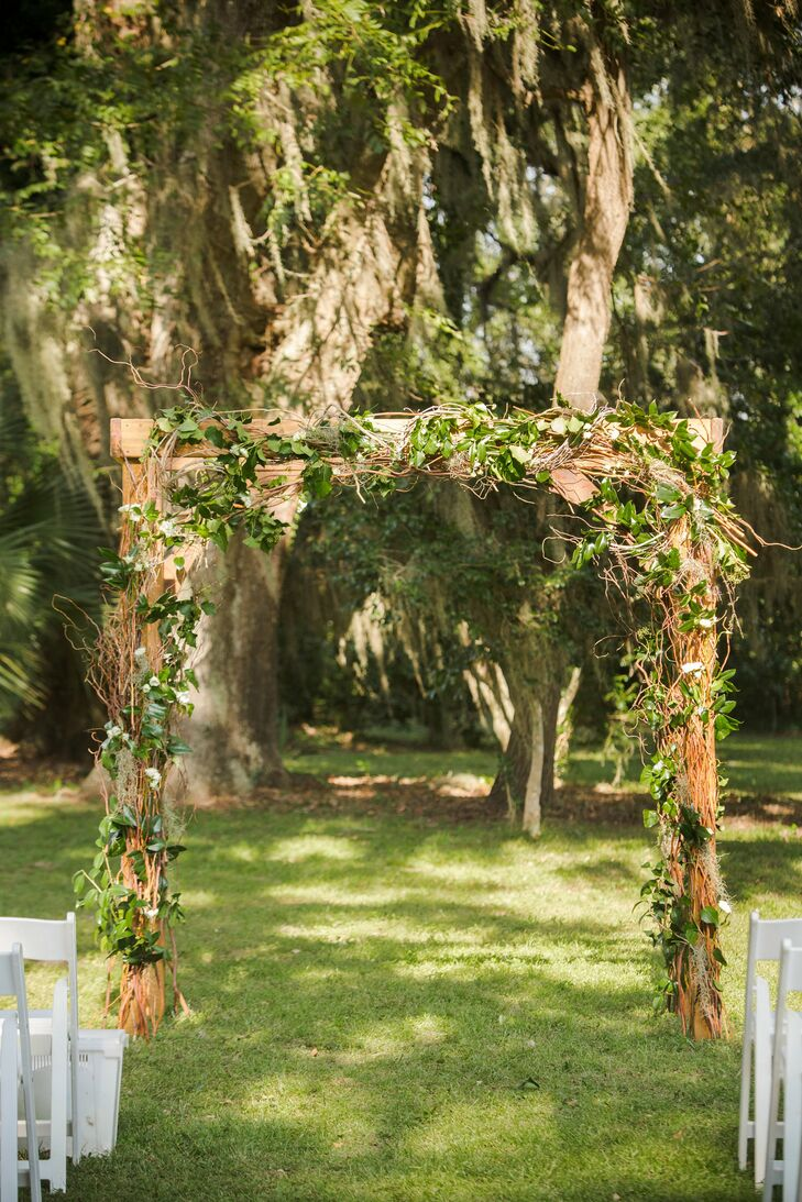 The ceremony took place beneath a wooden arch draped with grapevines, salal leaves and white spray roses.
