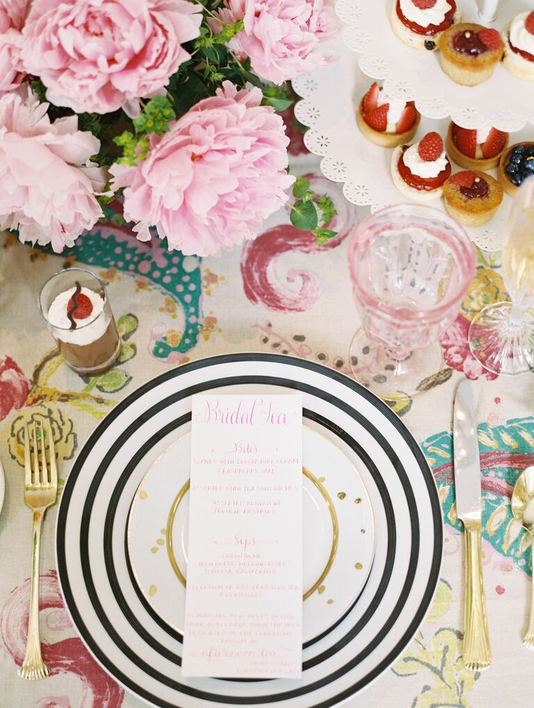 Colorful place setting with menu with pink calligraphy