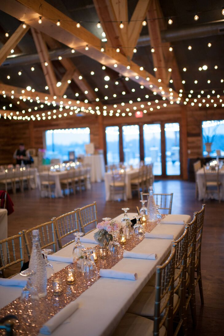 No two dining tables looked alike: Each was draped with seeded eucalyptus or sequined table runners with flowers, mixed metals, glassware and candles. String lights overhead added a romantic aura to the space.