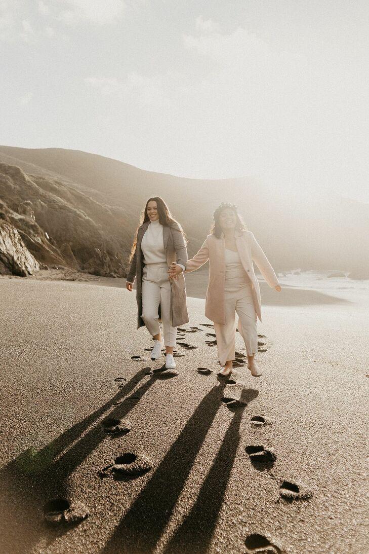 Couple Walking Along the Beach at Sunrise