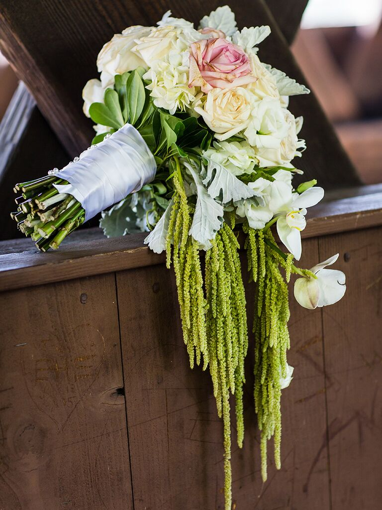 Cascading wedding bouquet idea with orchids and roses