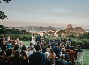 Inspired by their venue's panoramic views of the mountains and the sea, Maite and Nolan Simoneaux planned a rustic-chic wedding with a tropical twist