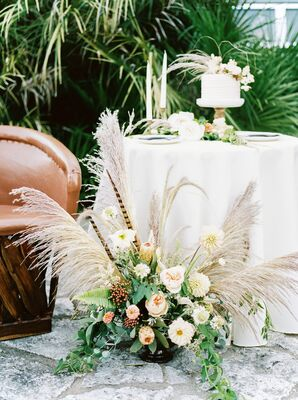Cake Table with Arrangement of Pampas Grass, Dahlias, Feathers, Peonies and GReenery