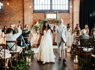Lucinda Nixon and Jonathan Elder wed at CAVU TPA, a restored automobile showroom built in the 1920s that connected to one of their favorite coffee sho