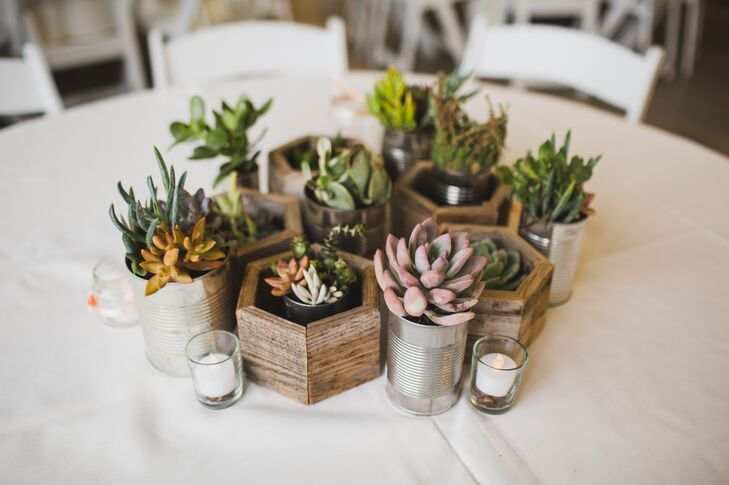 Elisa's stepfather, Rick, helped with all the wooden accents in the DIY centerpieces, including wooden hexagons, planter boxes and chopped-wood slices for the succulents.