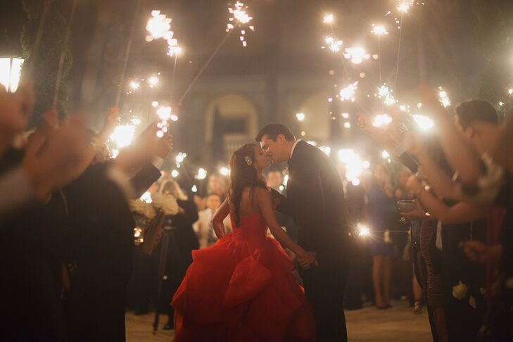 Amina and Brian were surrounded by their 170 friends and family members as they left the reception in a festive sparkler exit.