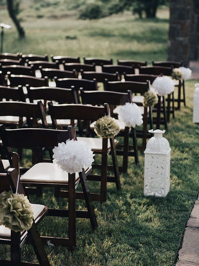 Gold and white tissue paper poms aisle decor for a wedding ceremony