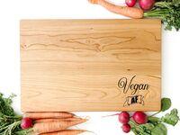 Wooden cutting board with 'Vegan AF' in black type in bottom corner