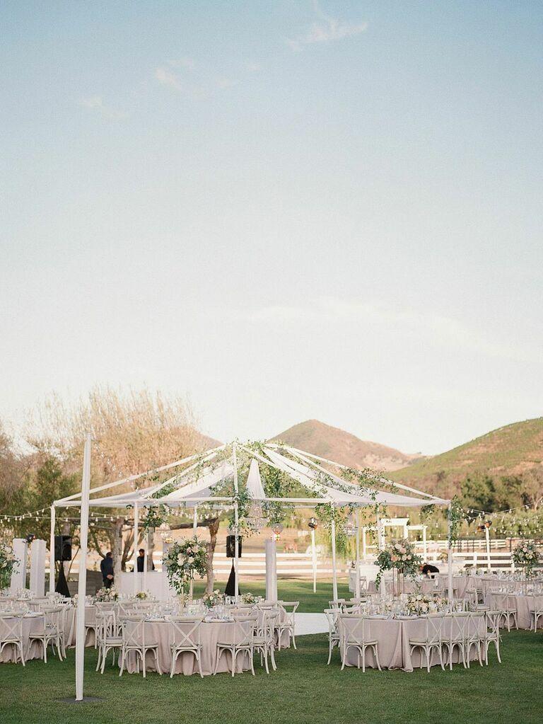 Open-air wedding reception tent at barn venue