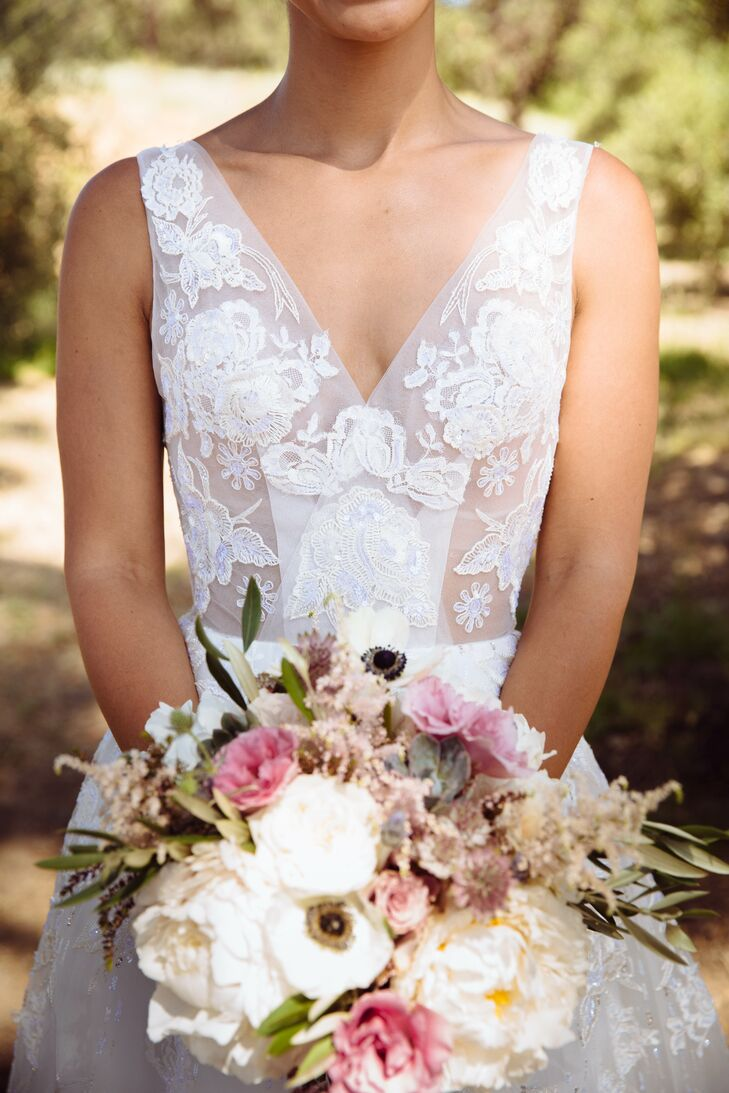 """""""An A-line ball gown may not be the traditional choice for a garden wedding, but I knew it would complement Campovida's wild garden setting perfectly,"""" she says. """"Looking back, splurging on my dream dress was one of the best decisions I made."""""""