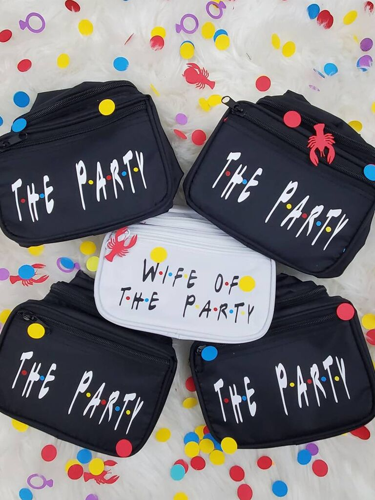 Black fanny packs with 'The party' in white Friends font, 'Wife of the party' in white with black type