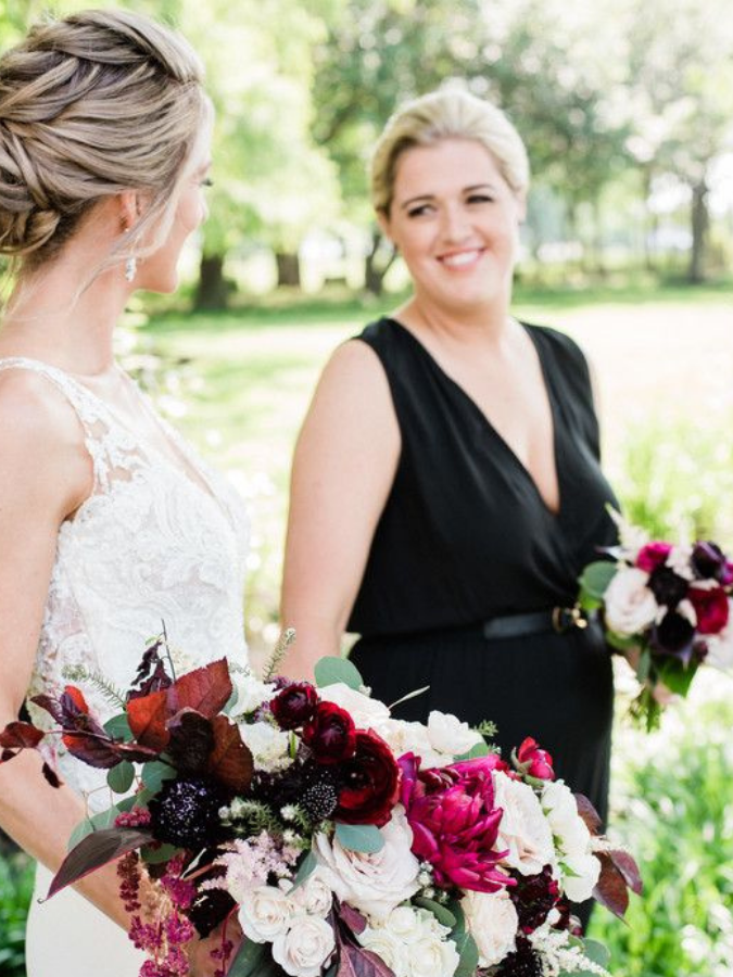 Two brides holding bouquets