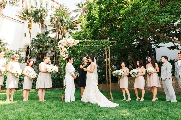 Andrea and Mariko exchanged vows in the Santa Barbara County Courthouse's Sunken Garden under an arch crafted by Ella and Louie Floral Design.