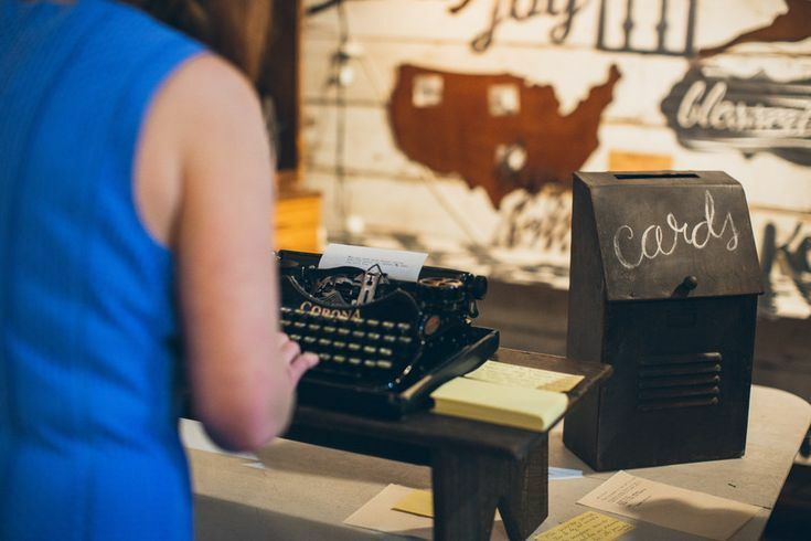 Person typing on typewriter guest book