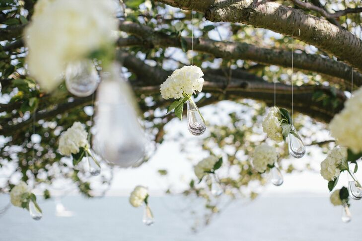 With such a beautiful venue, the couple wanted to keep decorations to a minimum, so all they used were small vases of hydrangeas hanging from the cherry tree.